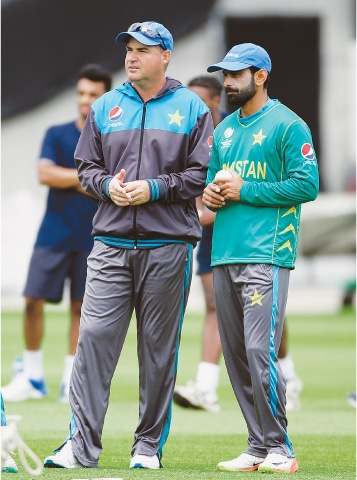 LONDON: Pakistan batsman Mohammad Hafeez (R) is seen alongside head coach Mickey Arthur during nets at The Oval on Friday ahead of the Champions Trophy final against India.—Reuters