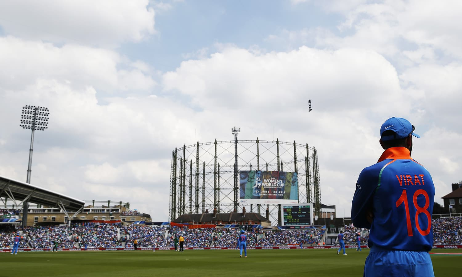 Virat Kohli watches the action from the boundary.─Reuters