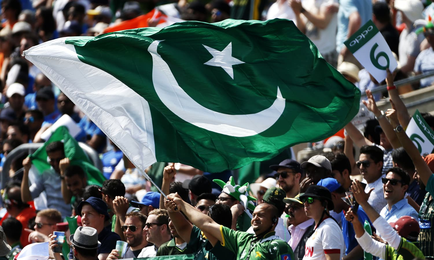Pakistani fans celebrate a six.─Reuters