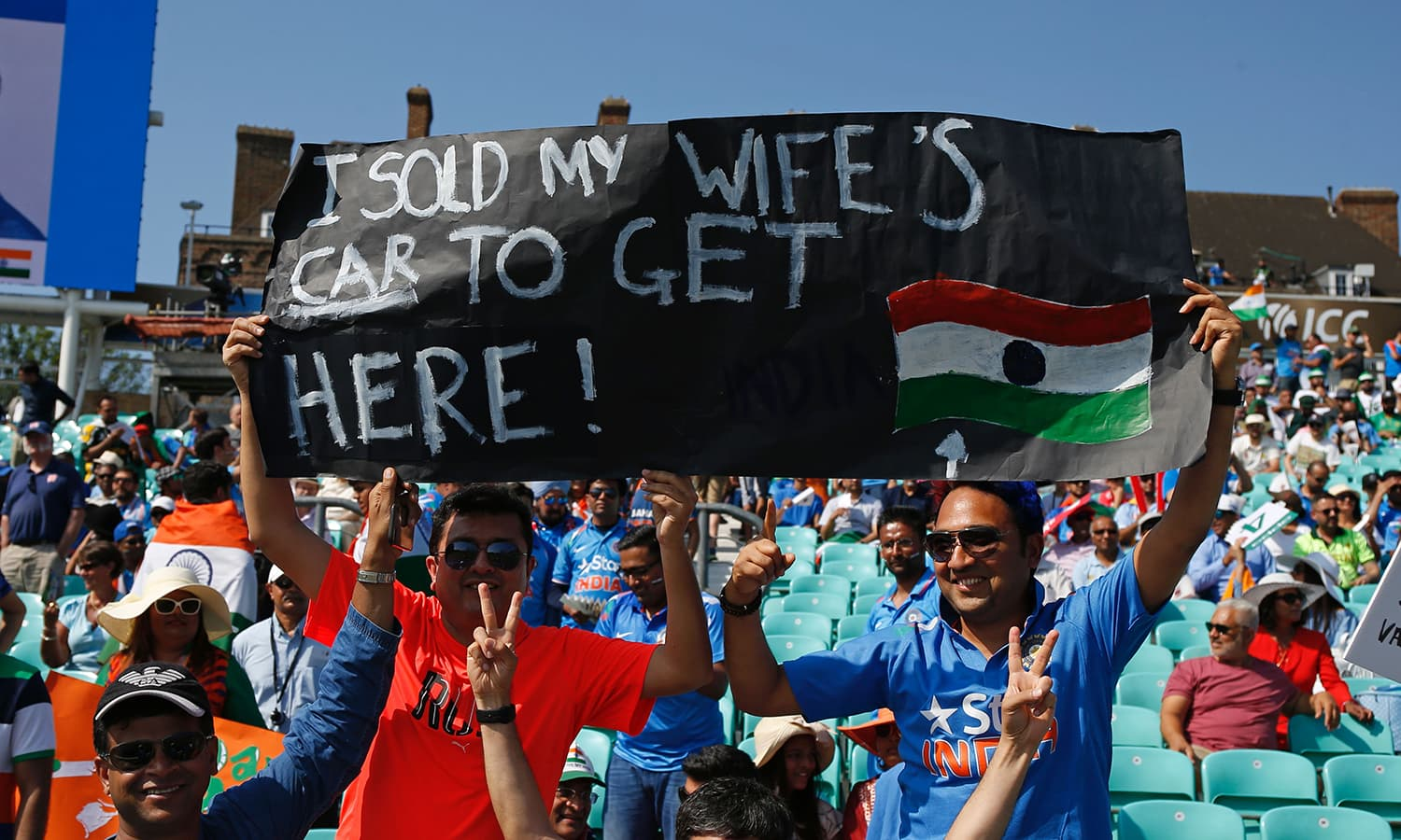 An Indian supporter holds up a banner in the crowd at the Oval.─AFP