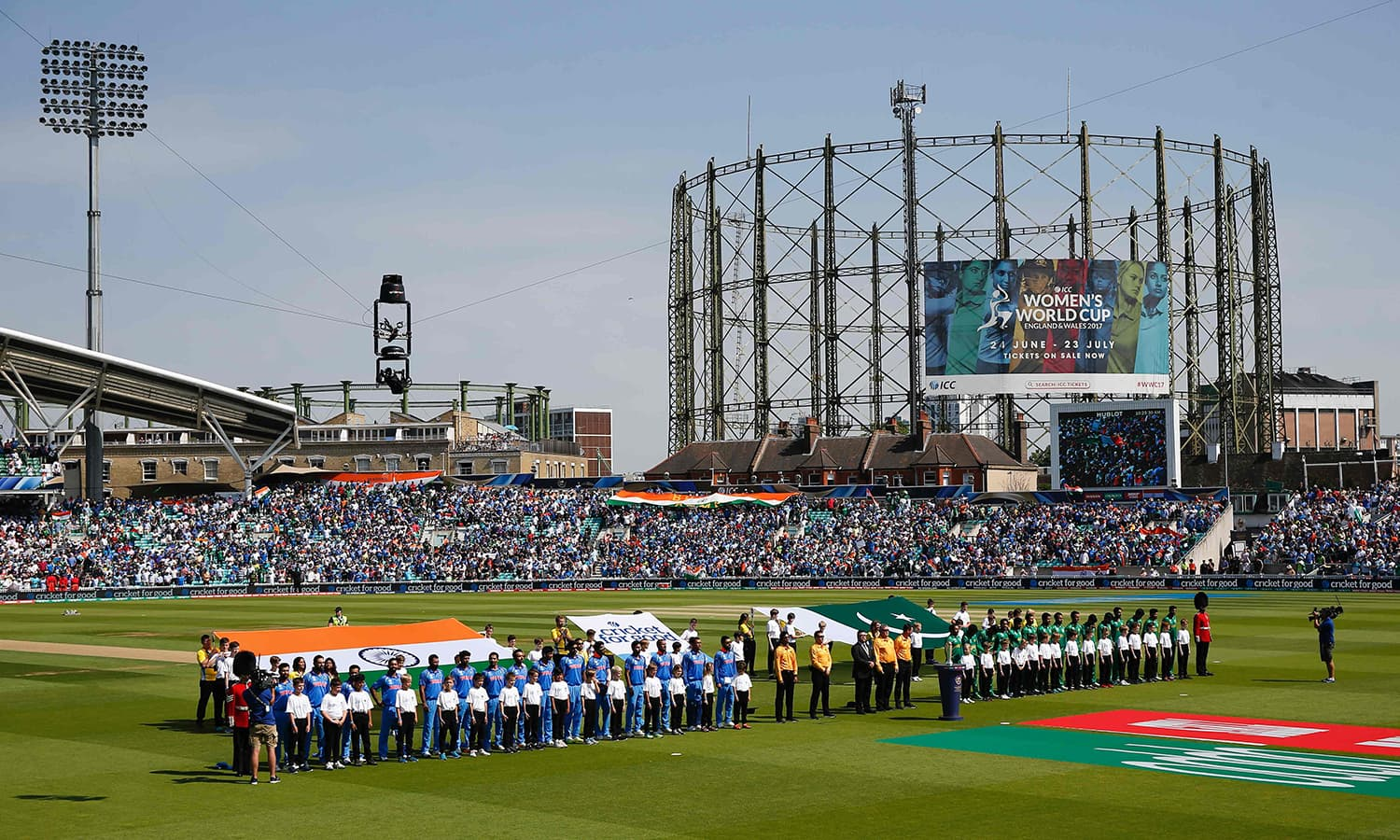 The teams line up on the pitch for the national anthems at the start of the ICC Champions Trophy final cricket match between India and Pakistan at The Oval in London.─AFP