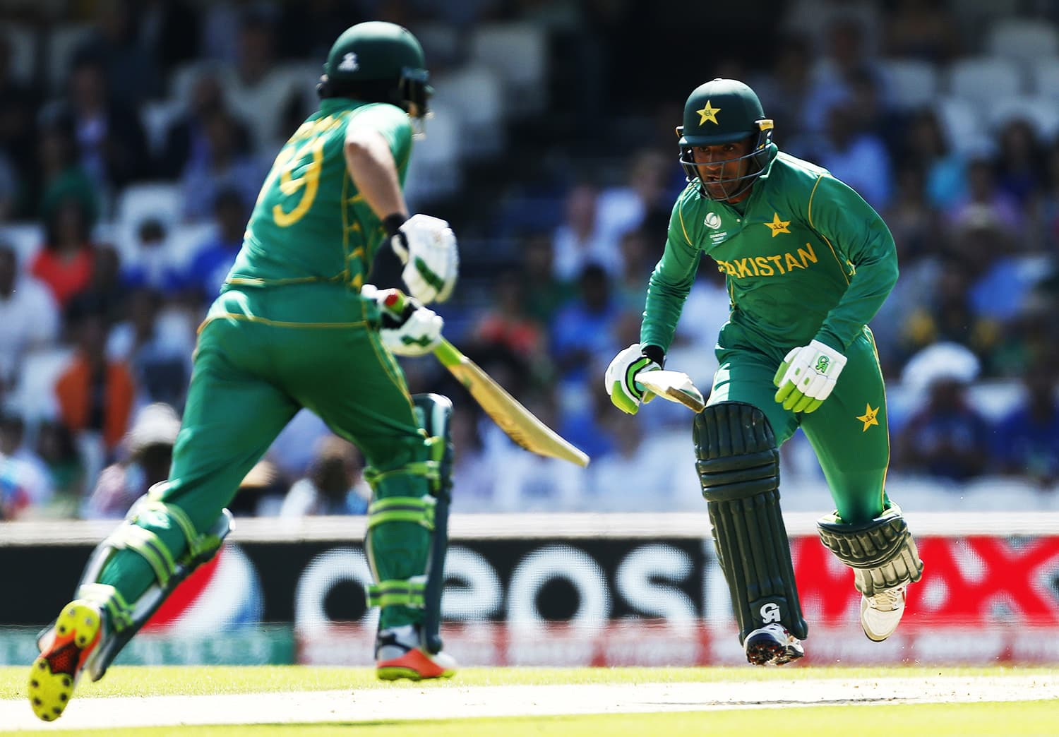 Azhar Ali (L) and Fakhar Zaman take crucial runs against India.─Reuters