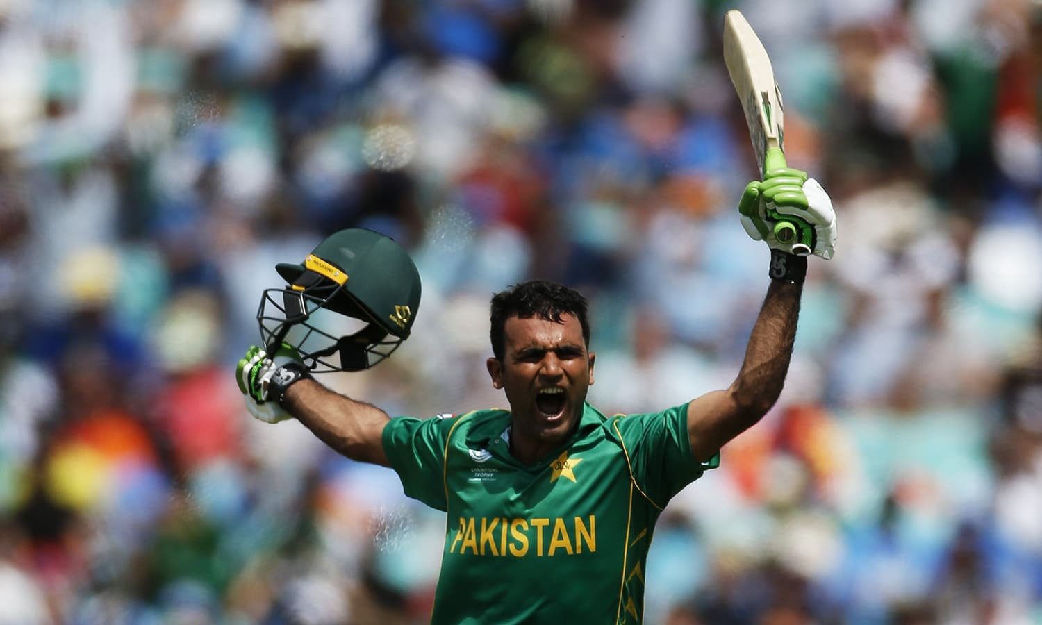 Fakhar Zaman celebrates his century, going on to score 114 runs before being caught out on a Hardik Pandya ball.─Reuters