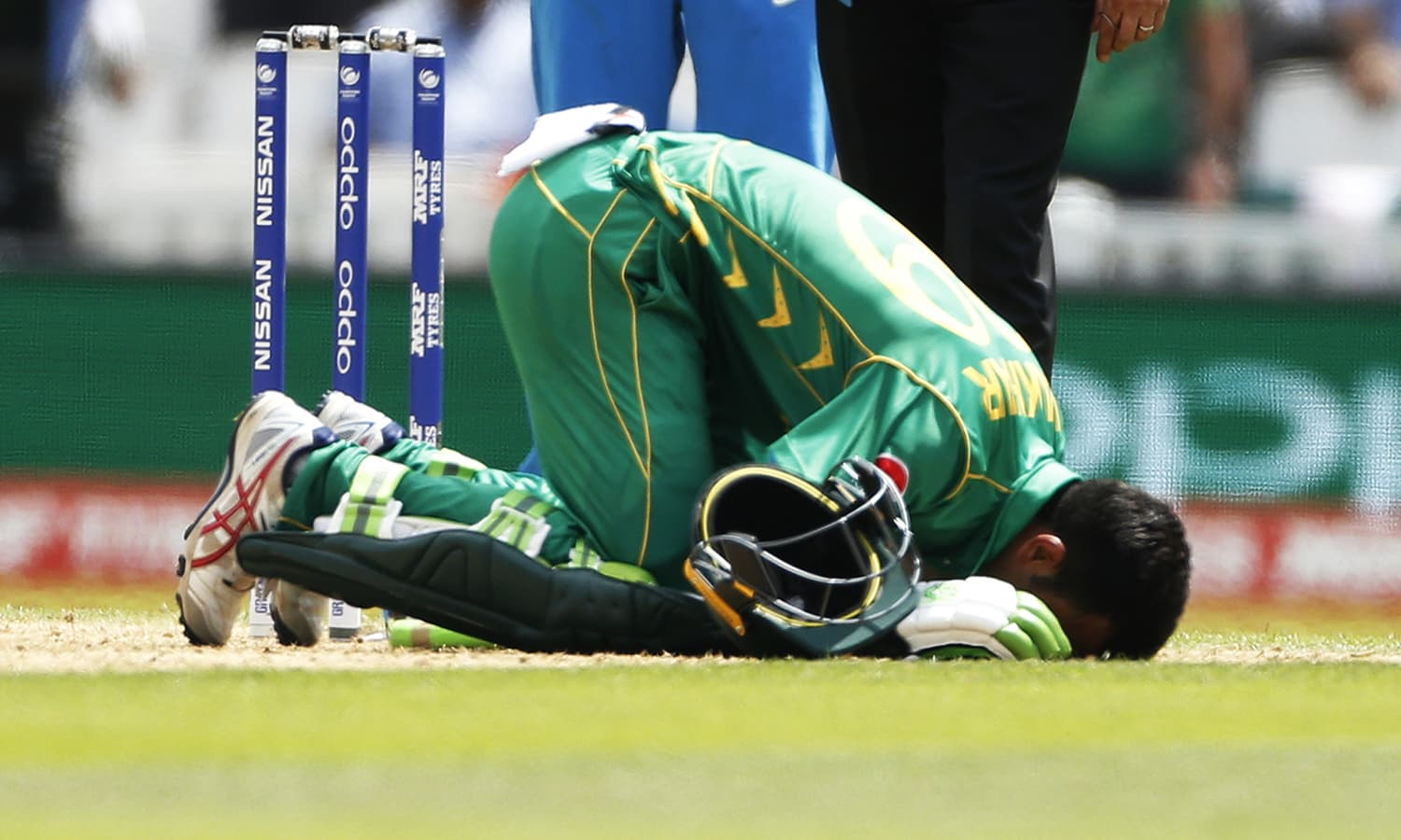 Fakhar Zaman prostrates following his century.─Reuters