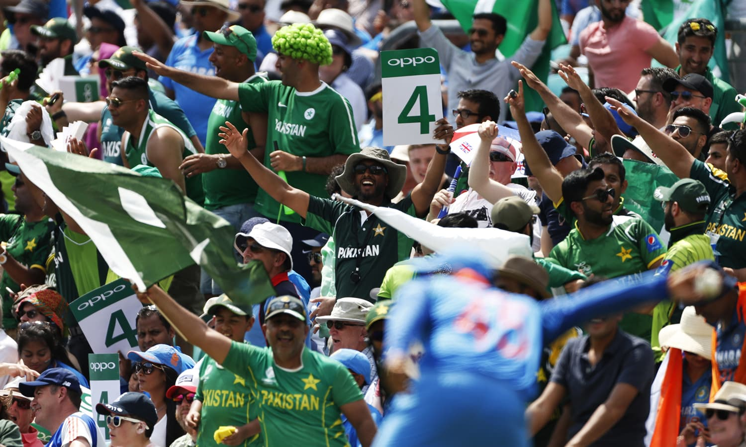 Pakistan fans celebrate a four as Rohit Sharma fields the ball.─Reuters