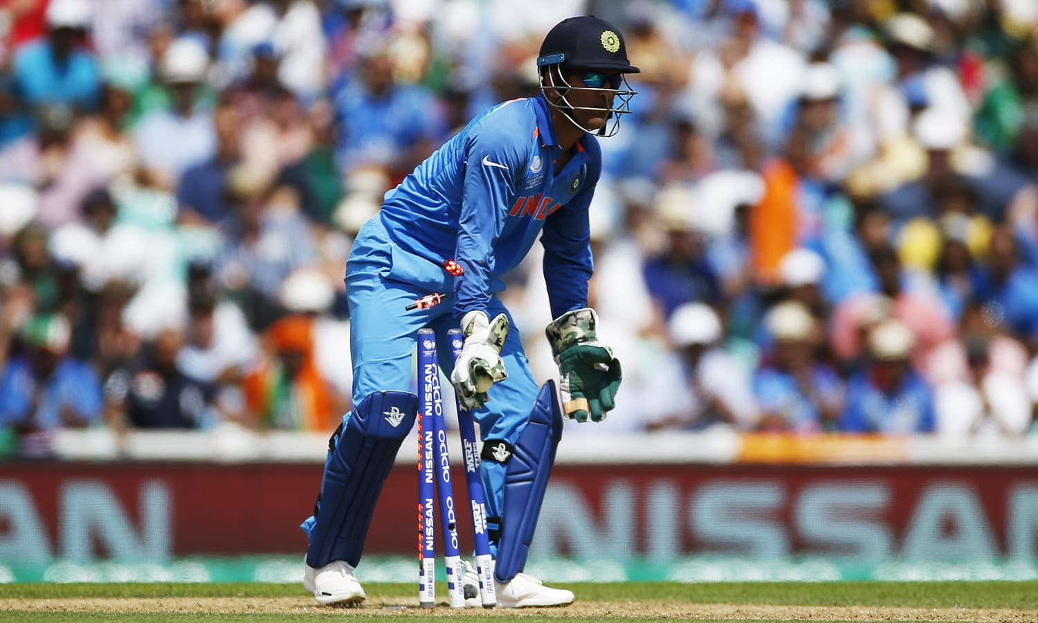 MS Dhoni runs out Azhar Ali after the batting partners miscommunicated signals.─Reuters