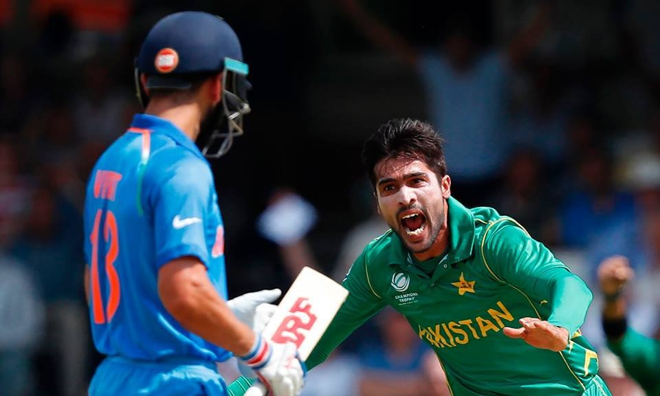 Mohammad Amir celebrates taking the wicket of India's Virat Kohli the ICC Champions Trophy final. ─ AFP