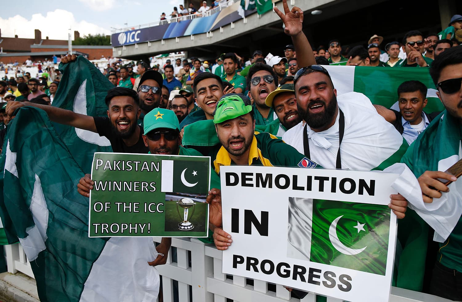 Pakistani fans hold posters describing the situation on the field. — AFP
