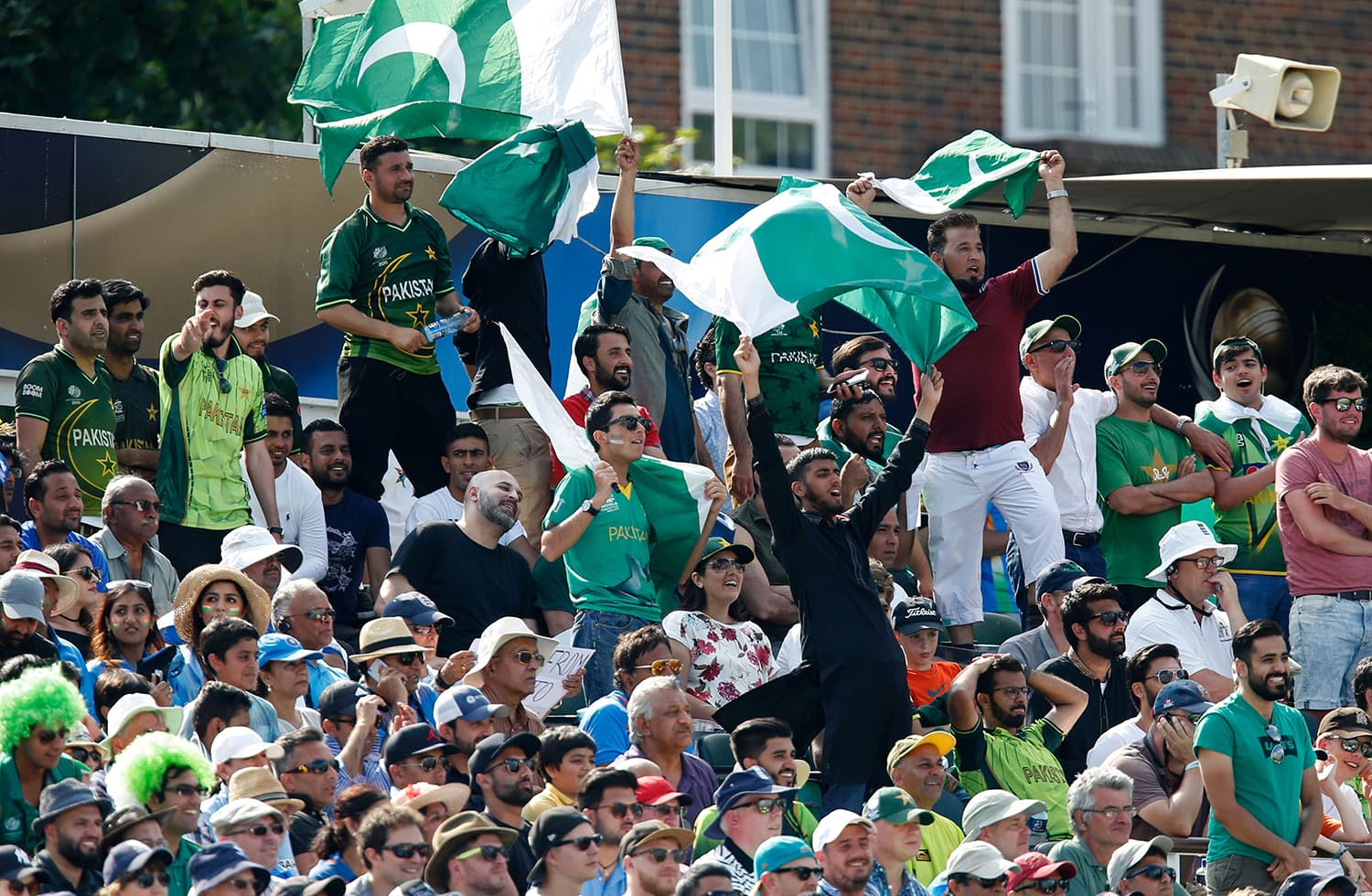Pakistani supporters go wild as the team wins big. — AFP