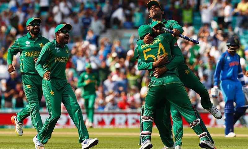 Pakistan celebrate their victory over India on the pitch after the ICC Champions Trophy final. ─ AFP