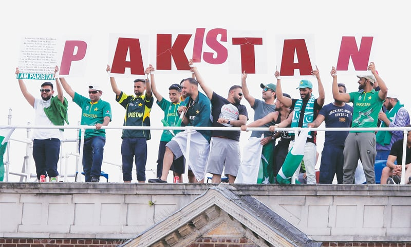 PAKISTAN fans watch the ICC Champions Trophy final against India from an apartment building outside The Oval on Sunday.—AP