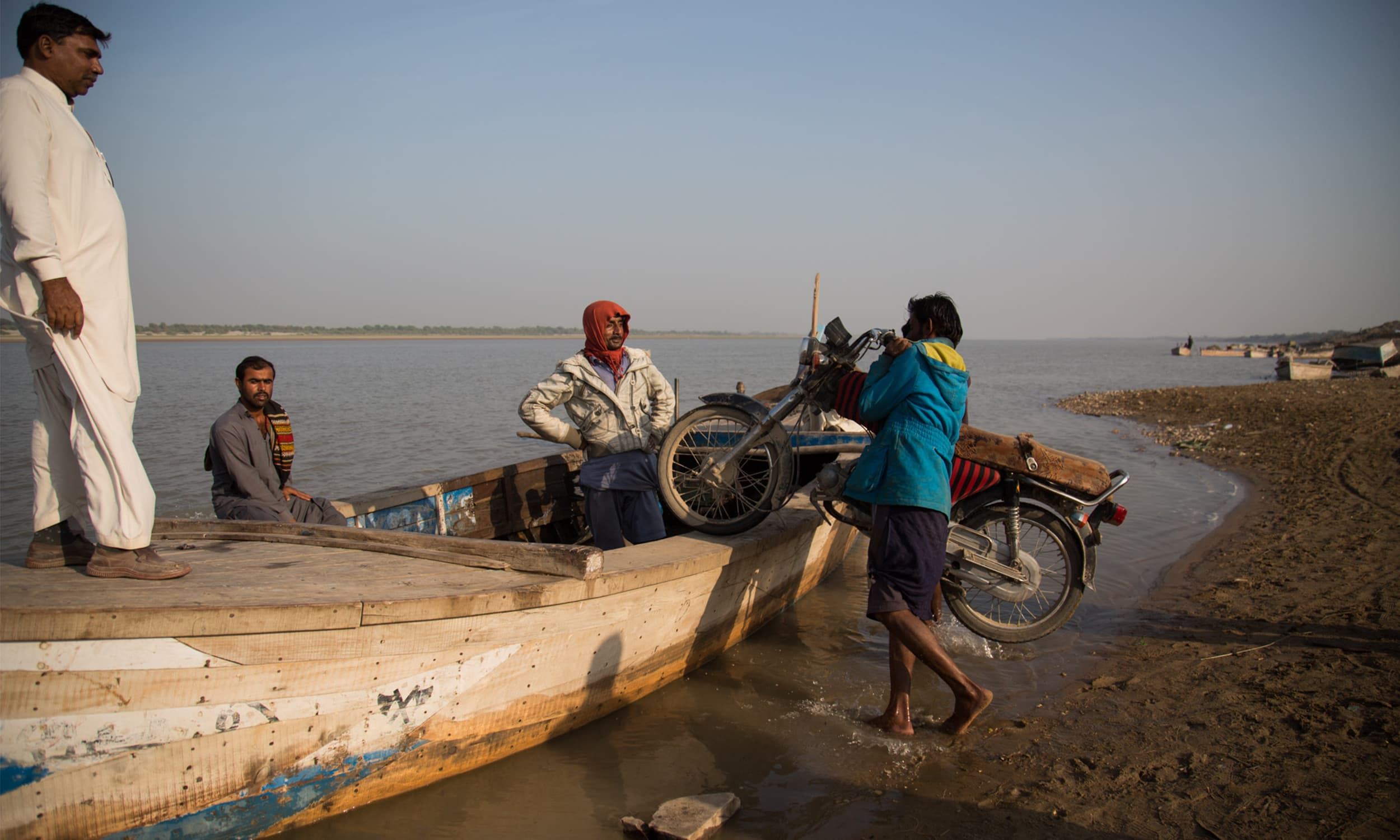 Locals use a boat to cross the Indus river from Sann on the west bank to get to villages on the eastern bank