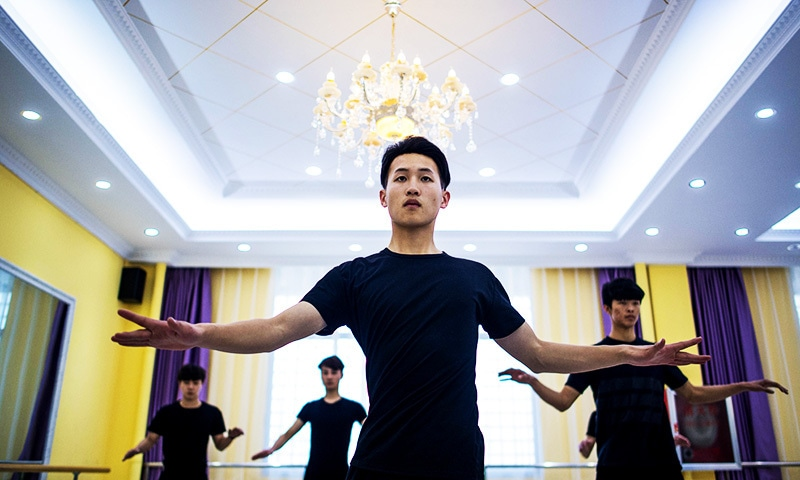 This picture shows Li Zhishu attending a dance class at the Yiwu Industrial & Commercial College in Yiwu.— AFP