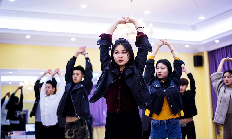 This picture shows Wang Xin attending a dance class at the Yiwu Industrial & Commercial College in Yiwu.—AFP