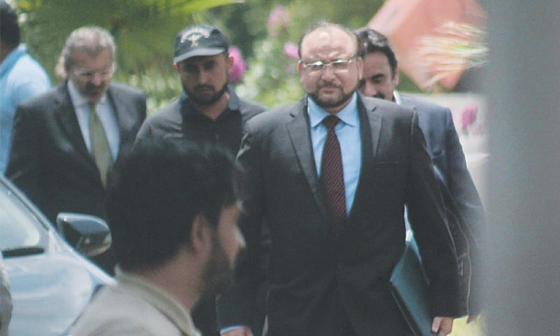 MEMBERS of the Joint Investigation Team, led by the Federal Investigation Agency's Additional Director General Wajid Zia, arrive at the Supreme Court on Monday.—Online