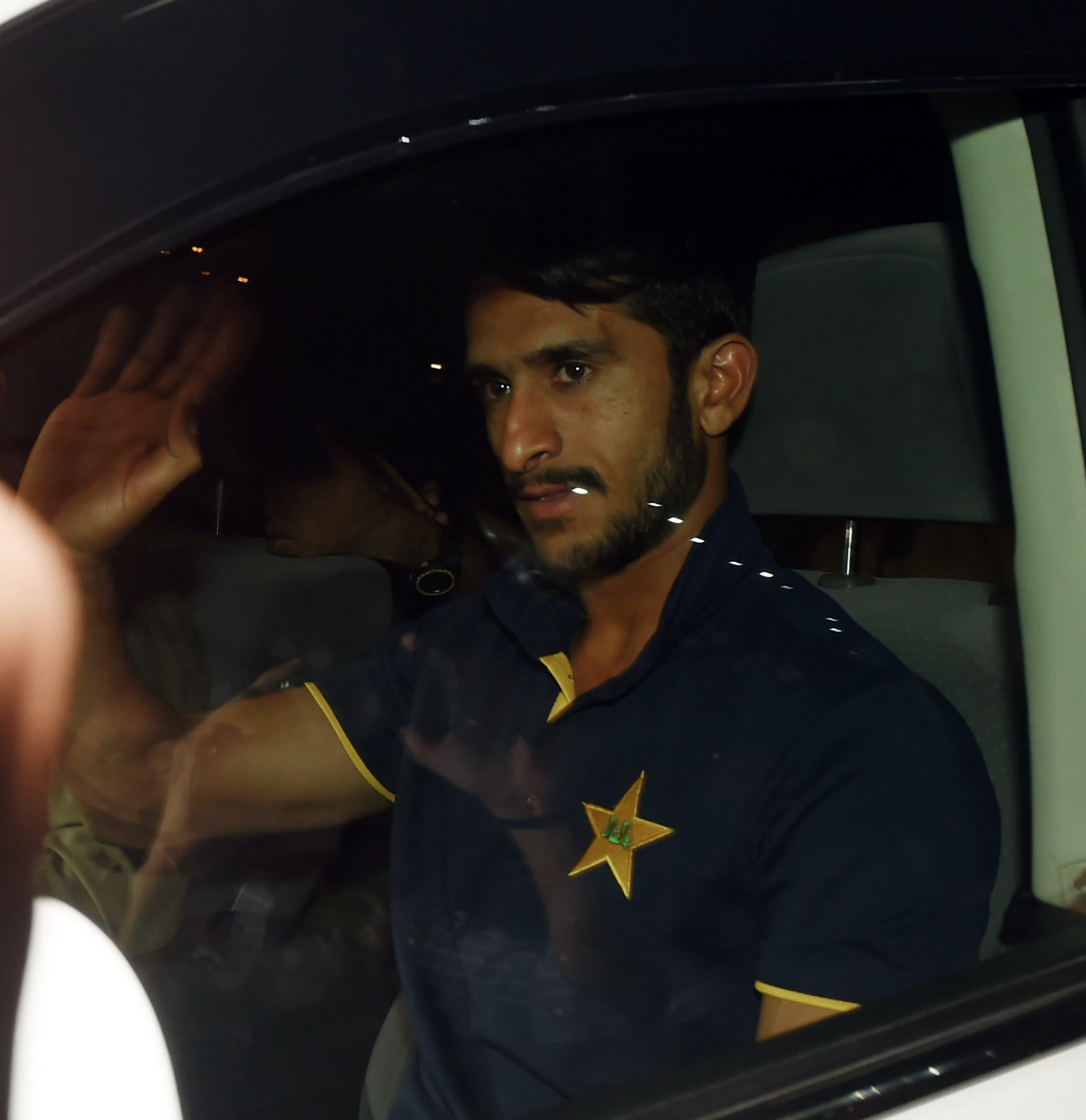 Hasan Ali waves to fans upon his arrival from London outside the Allama Iqbal International airport in Lahore.─AFP