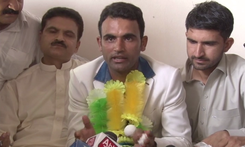Fakhar Zaman speaks to reporters at his home in Mardan.─DawnNews
