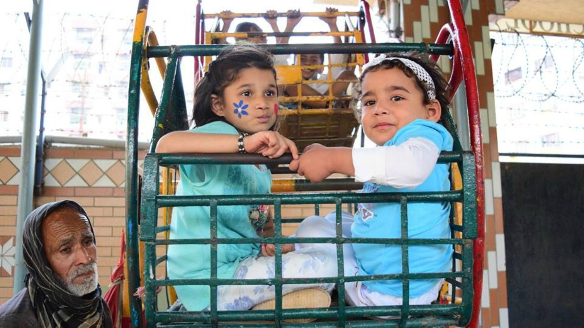 Children enjoying a carnival held by Kiran Foundation.