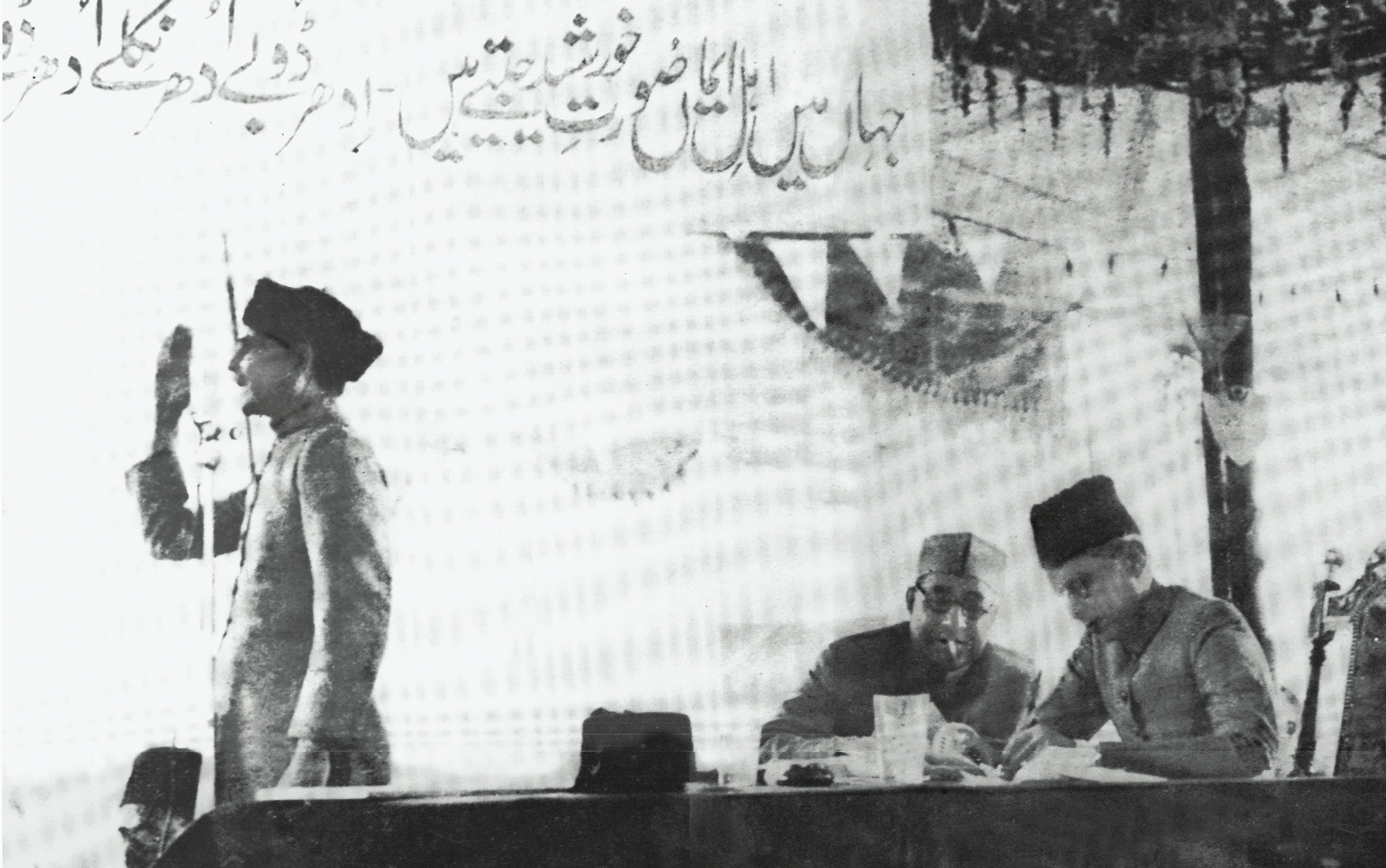 Quaid-i-Azam, Mohammad Ali Jinnah and Nawabzada Liaquat Ali Khan peruse the Lahore Resolution. — Courtesy Lahore Museum