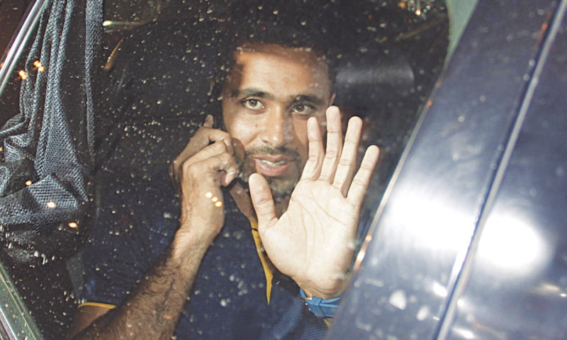 ALL-ROUNDER Fahim Ashraf waves to fans after reaching Lahore.—INP
