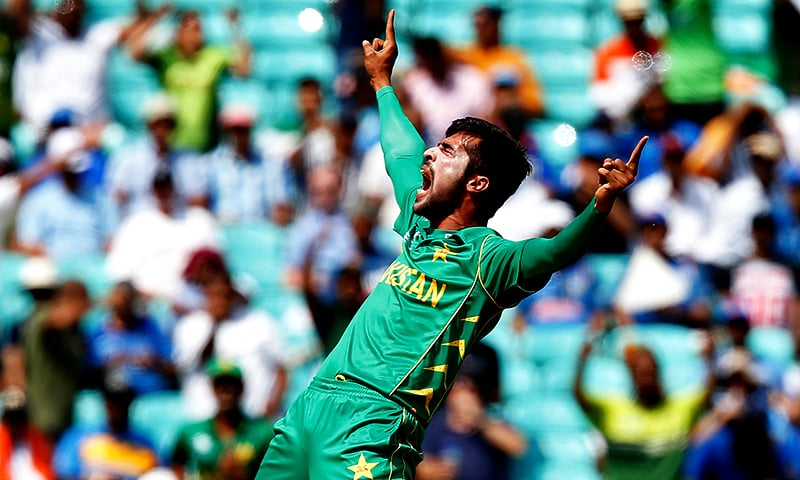 Mohammad Amir celebrates taking the wicket of India's Rohit Sharma. ─ AFP/File