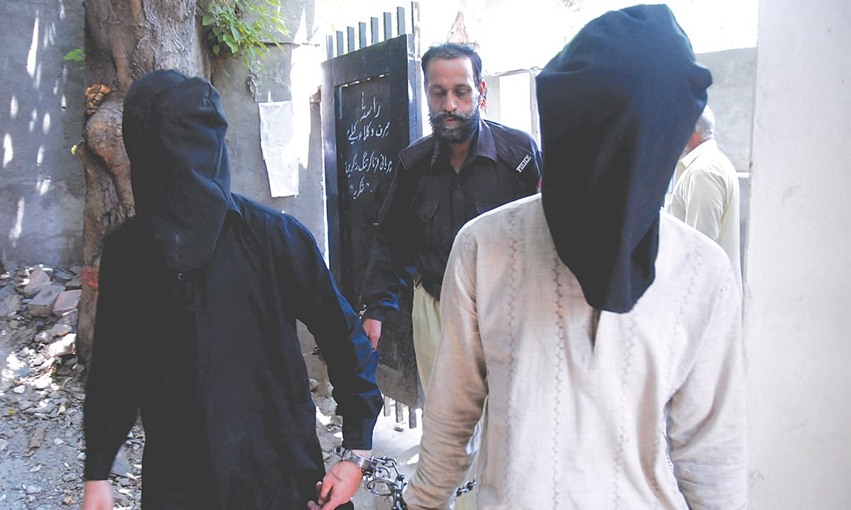 Arrested suspects being brought for a hearing at District and Sessions Court, Rawalpindi | Mohammad Asim, White Star