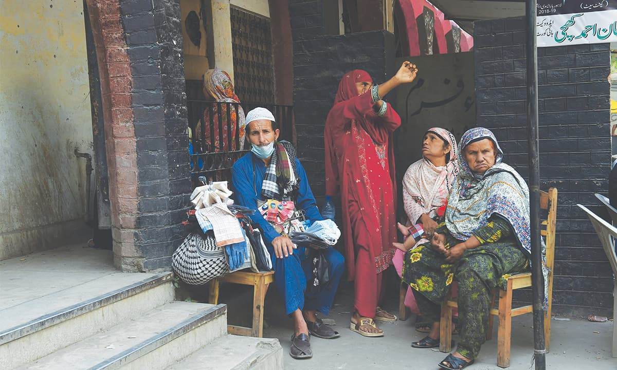 A family waits for a hearing | M Arif, White Star
