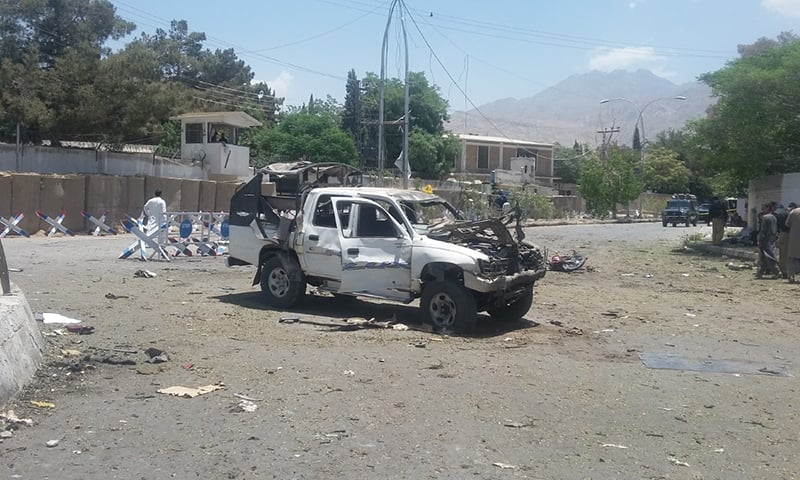 Damaged car at the site of the bombing.