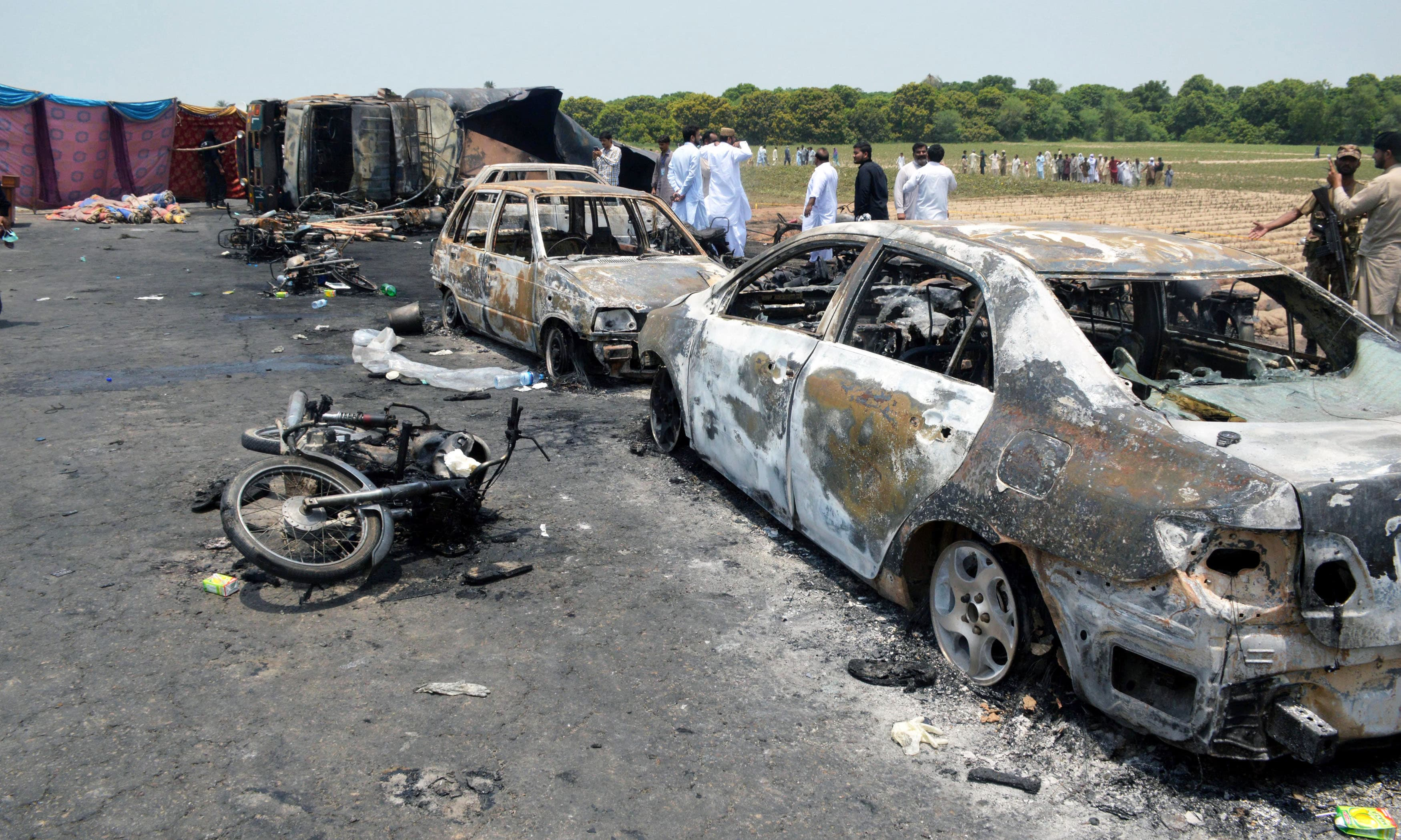 Burnt out cars and motorcycles are seen at the scene of an oil tanker explosion in Bahawalpur. ─Reuters
