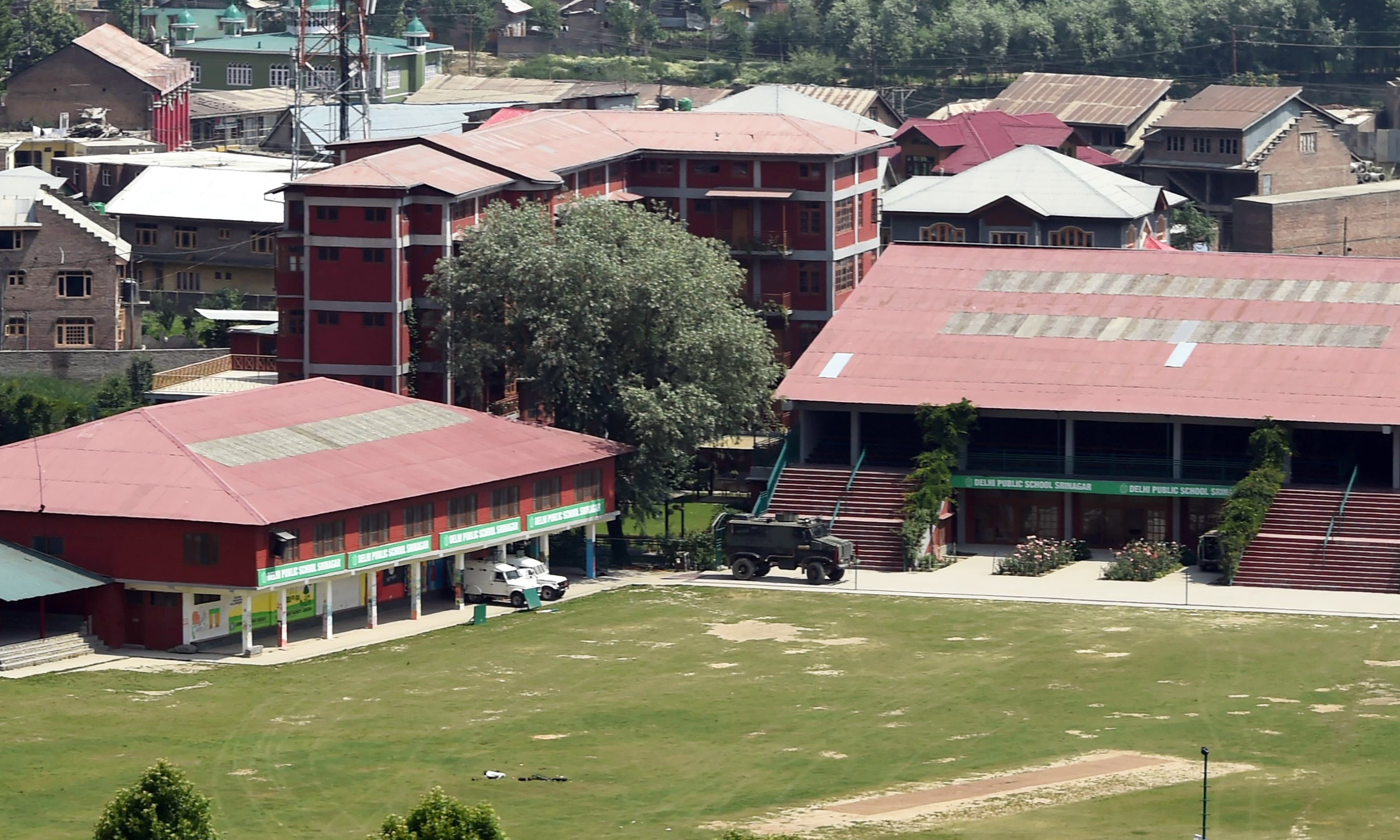Indian army vehicles are stationed inside the Delhi Public School during a gunfignt with suspected militants and Indian government forces at Panthachowk on the outskirts of Srinagar. —AFP
