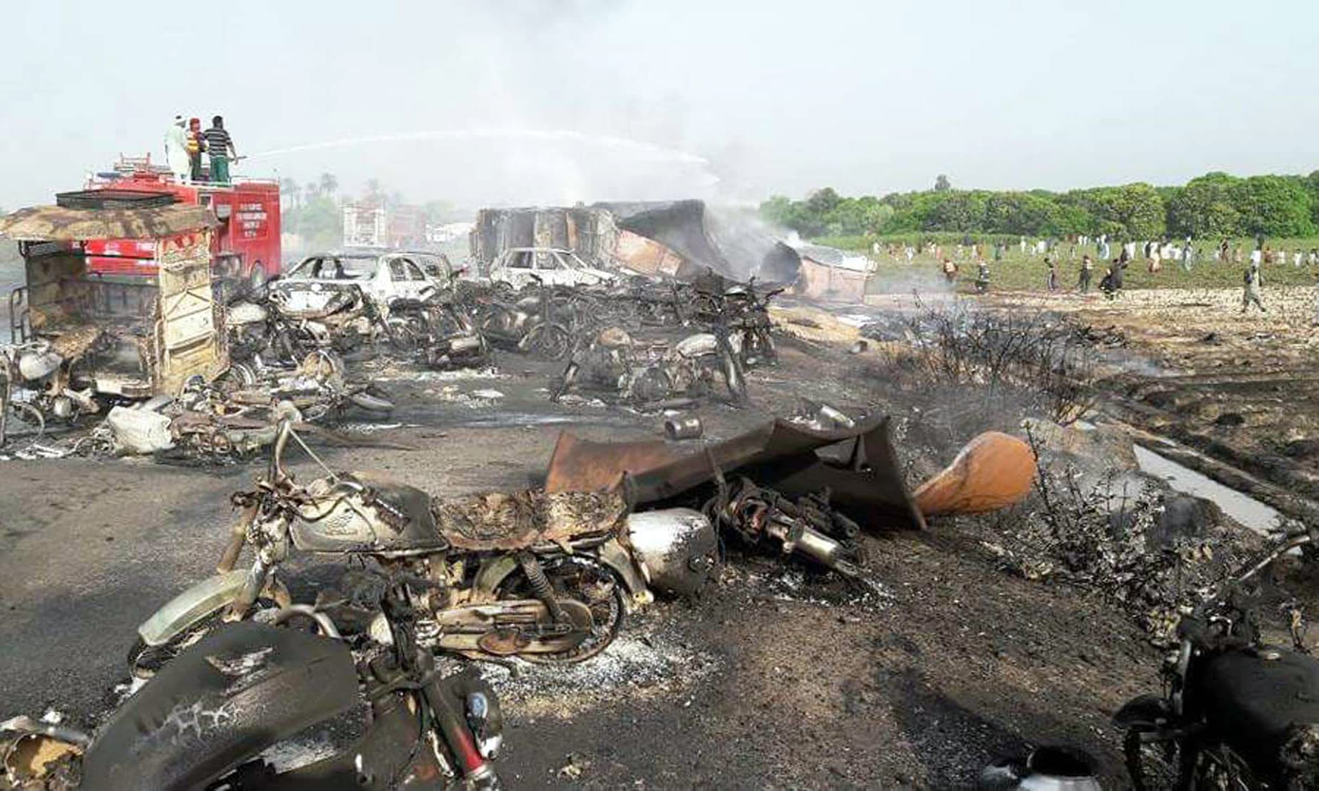 Burnt out cars and motorcycles are seen at the scene of an oil tanker explosion in Bahawalpur. ─PPI