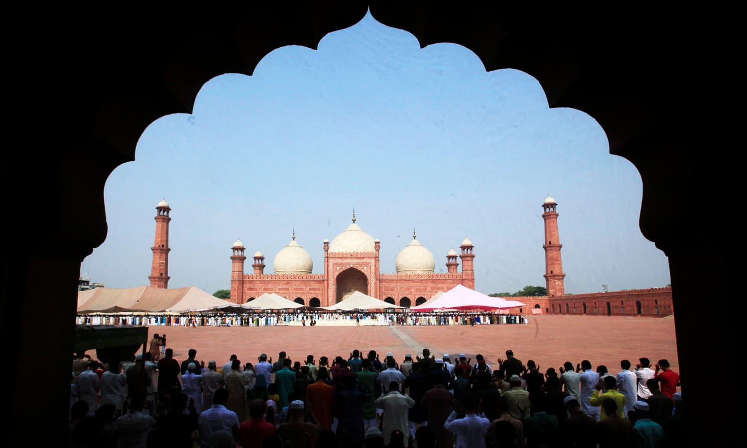 Men say their Eid prayers to mark the end of Ramzan at Badshahi mosque in Lahore. ─ Reuters
