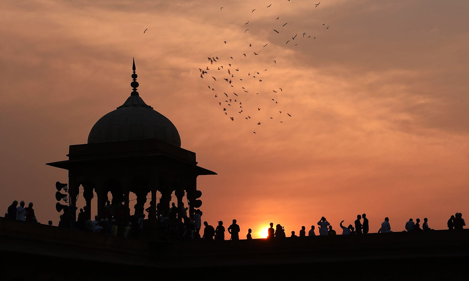 Indian Muslims gather in the early morning to offer prayers during Eid at Jama Masjid mosque in New Delhi. ─ AFP