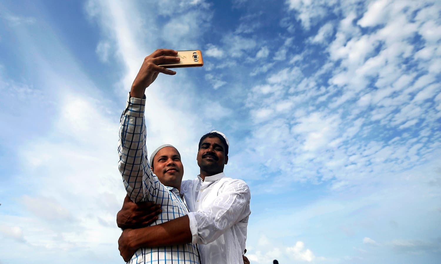 Two men takes selfies after Eid prayers in Colombo, Sri Lanka. ─ Reuters