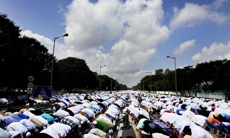 Muslims offer Eid prayers in Kolkata. ─ AP