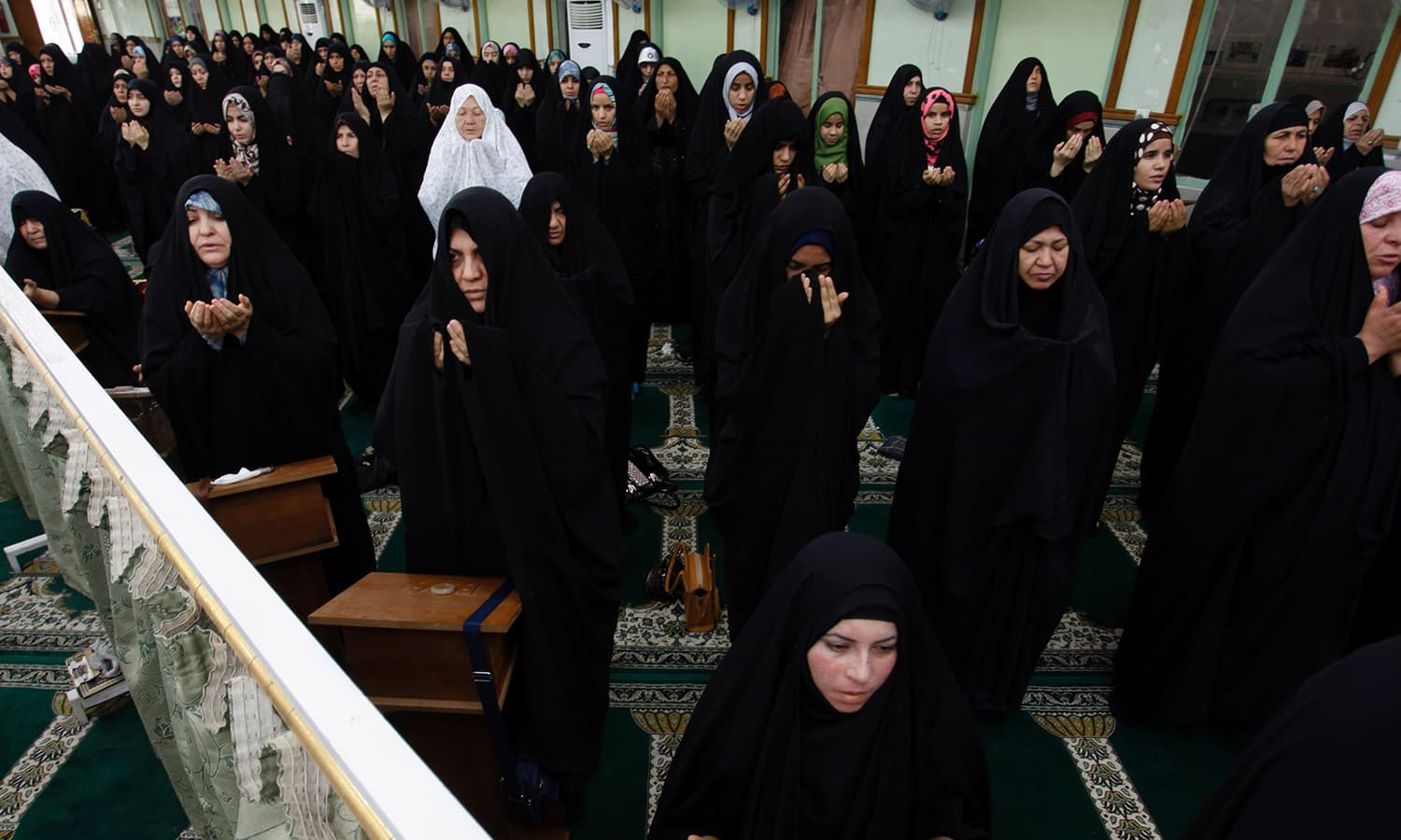 Iraqi women offer Eid prayers in the city of Najaf. ─ AFP