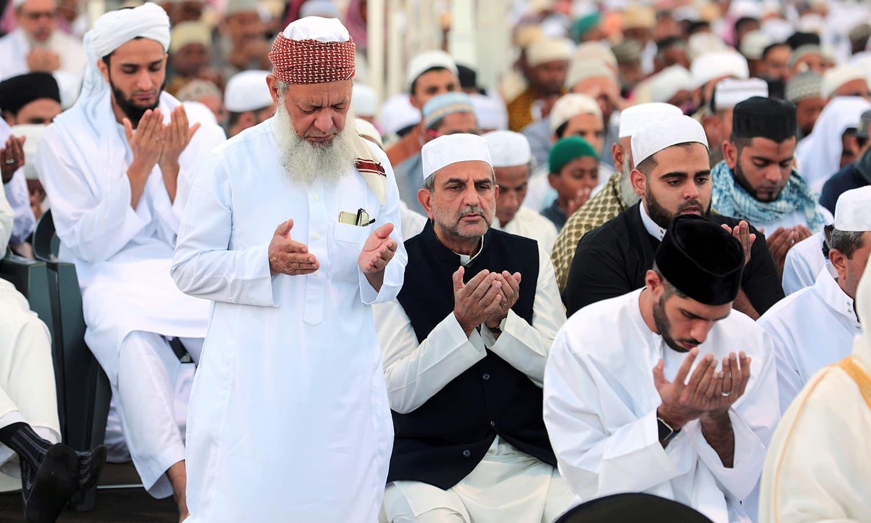 Muslims offer Eid prayers at the velodrome de Champ-Fleuri in Saint-Denis de la Reunion on the French Indian Ocean island of Reunion. ─ AFP