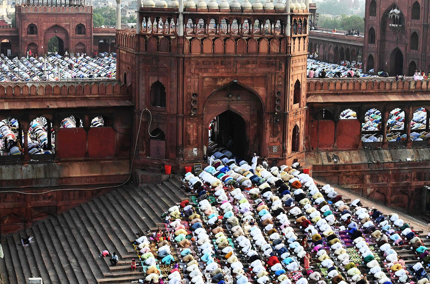 Indian Muslims offer prayers during Eid at the Jama Masjid mosque in New Delhi. ─ AFP