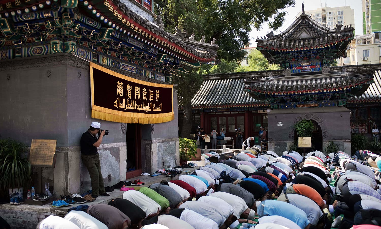 Chinese Muslims offer Eid prayers at the Niujie mosque in Beijing. ─ AFP