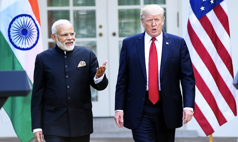 President Donald Trump and Indian Prime Minister Narendra Modi, step into the Rose Garden to make joint statements at the White House.─AP