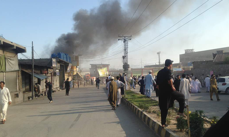 Smoke rises from the site of the explosion in Parachinar on Friday. ─ DawnNews