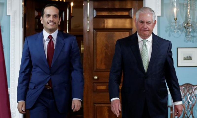 US Secretary of State Rex Tillerson  walks with Qatari Foreign Minister Sheikh Mohammed bin Abdulrahman Al Thani before their meeting at the State Department in Washington.─Reuters