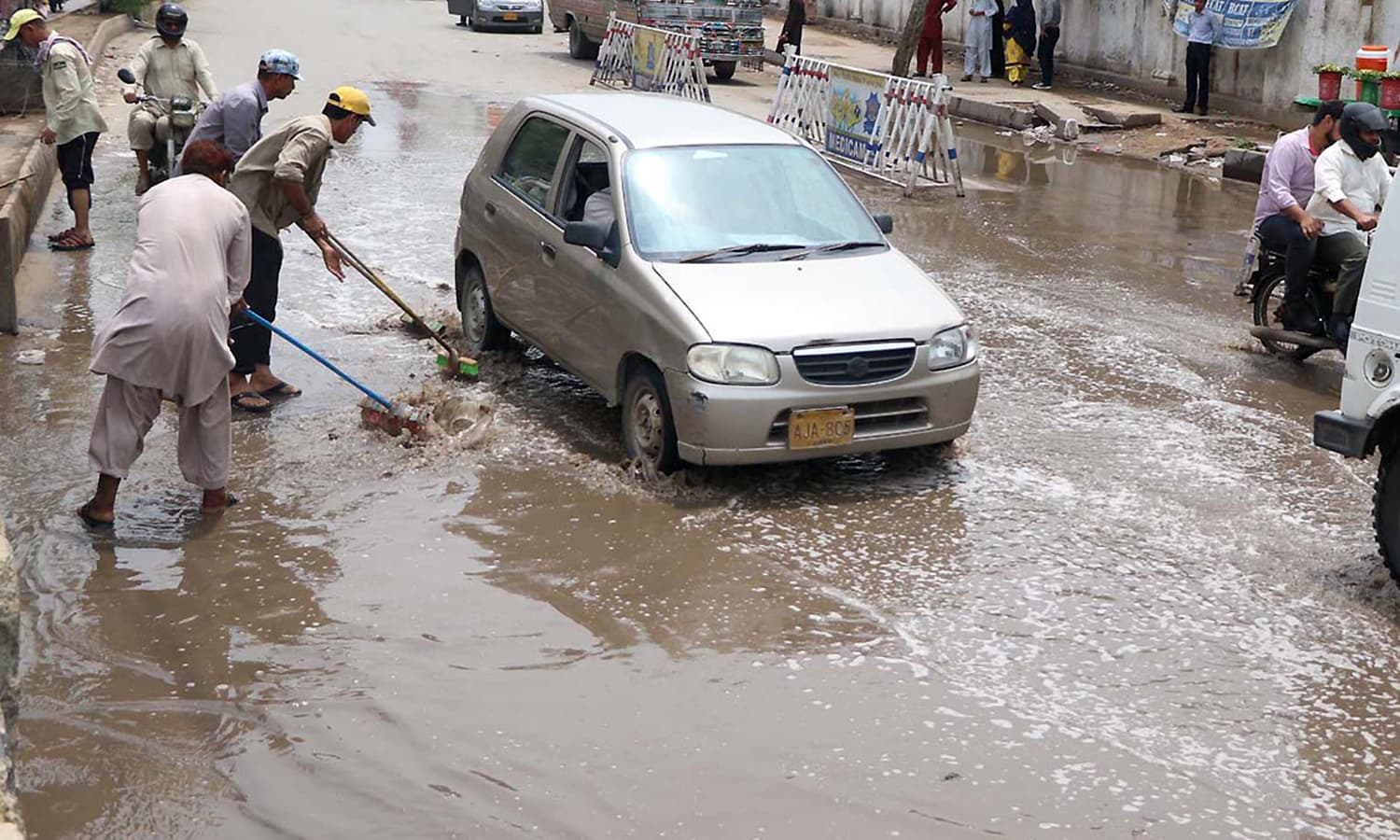 KMC staffers drain out stagnant rainwater from Karachi's Tower area.— Online
