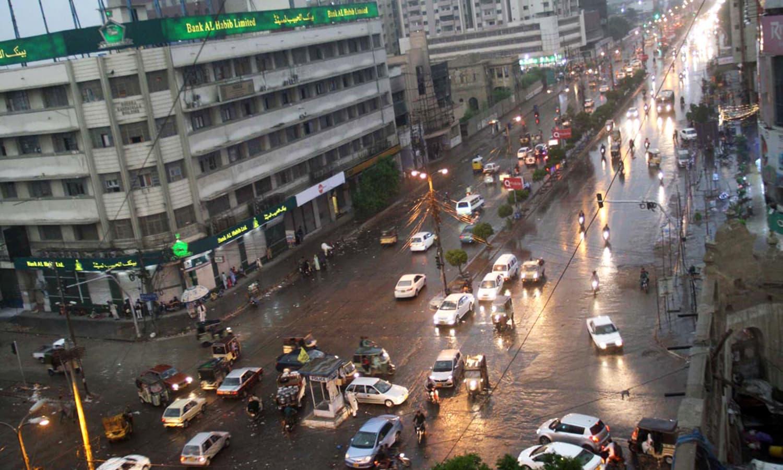 Motorists on their way during first monsoon rain in Karachi.— Online