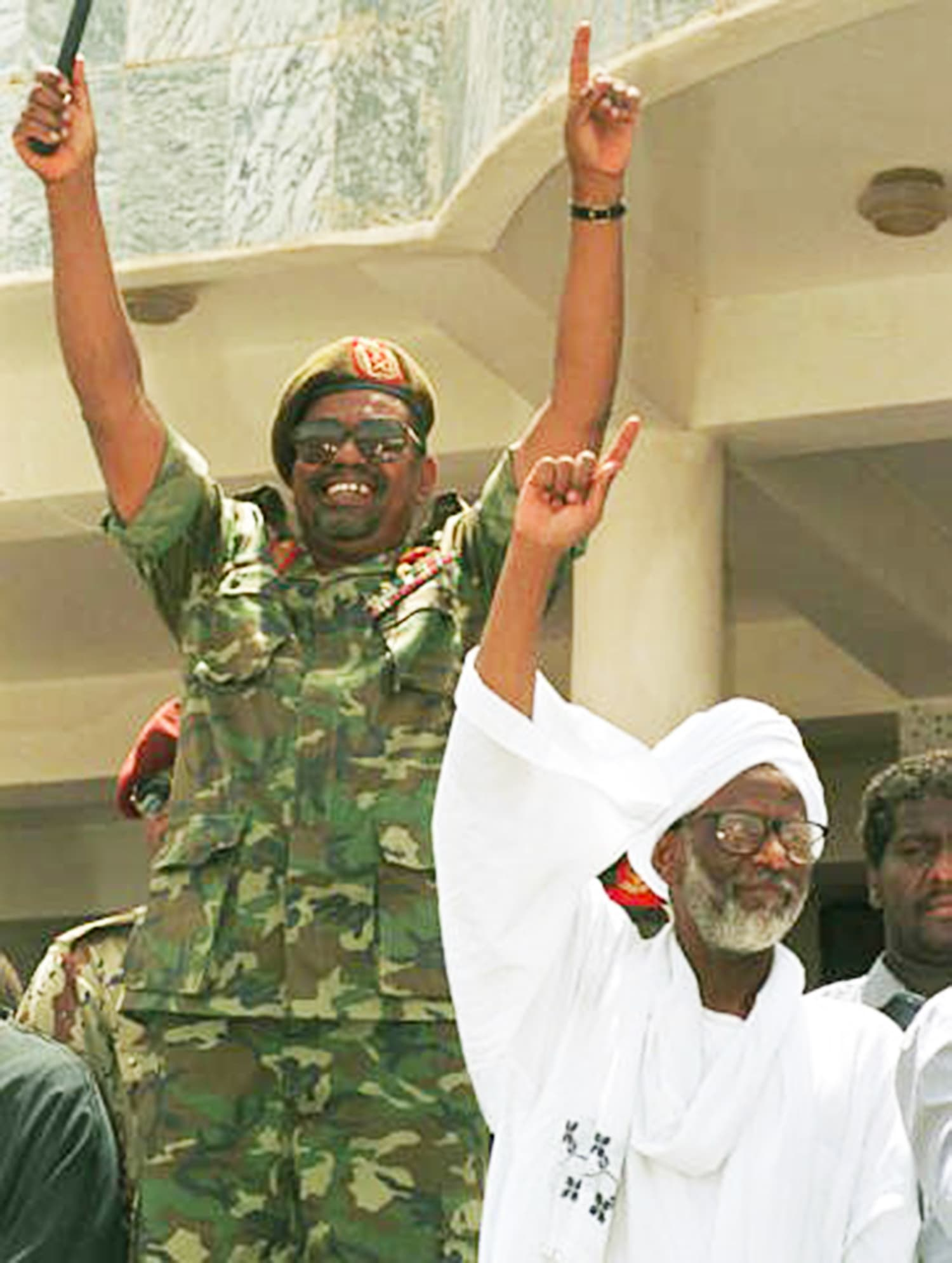 Bashir with Tirabi. — Photo: The Guardian.