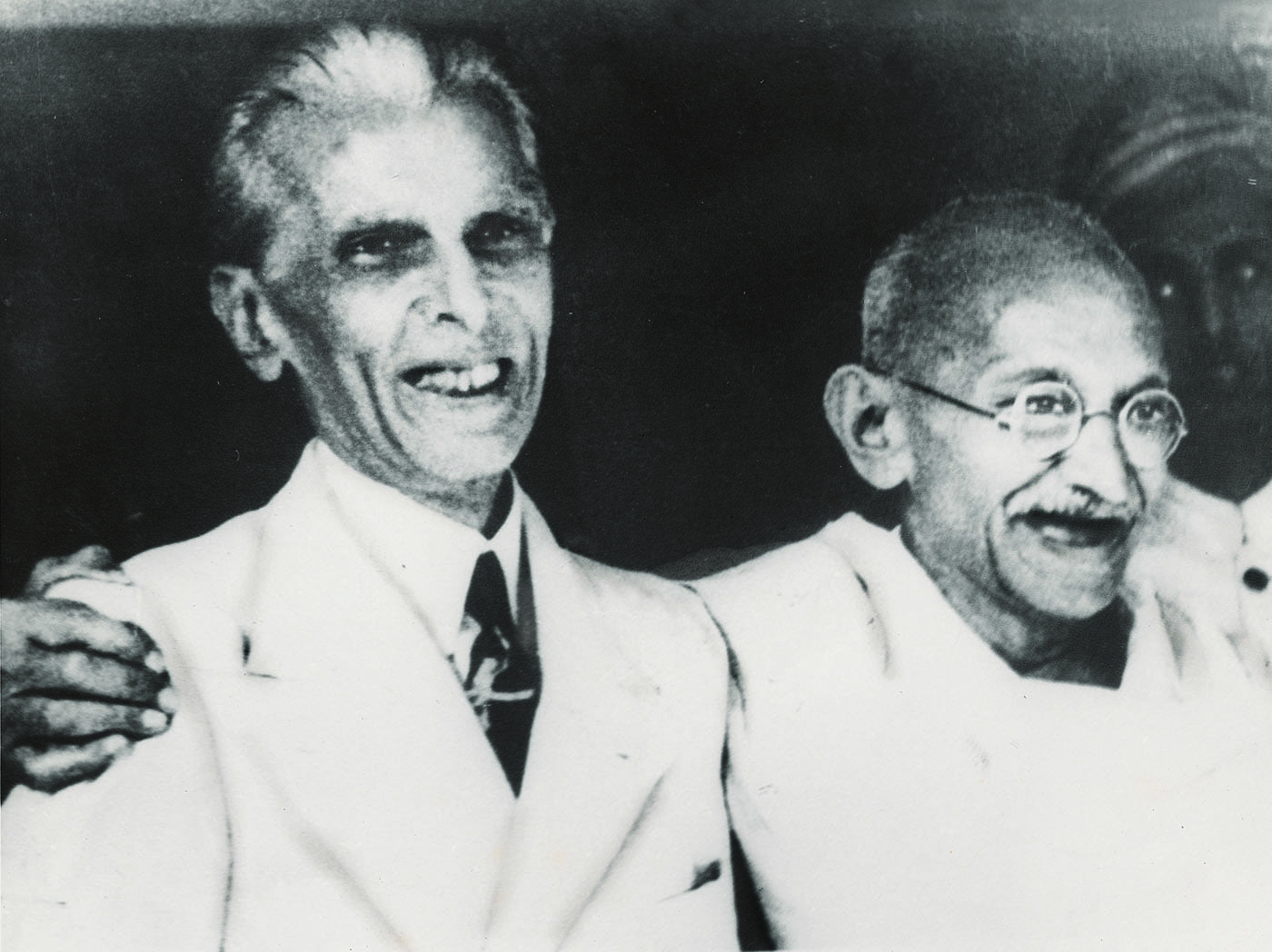 The Quaid-i-Azam, Mohammad Ali Jinnah and Mahatma Gandhi smile during the Jinnah-Gandhi talks. — Courtesy National Archives Islamabad