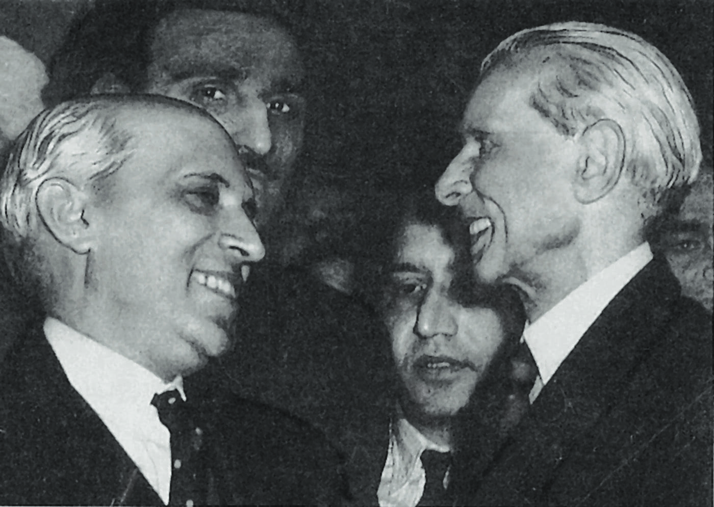 The Quaid-i-Azam, Mohammad Ali Jinnah and Jawaharlal Nehru caught smiling at each other at a reception at the India Office Library in London in December 1946. — Courtesy National Archives Islamabad