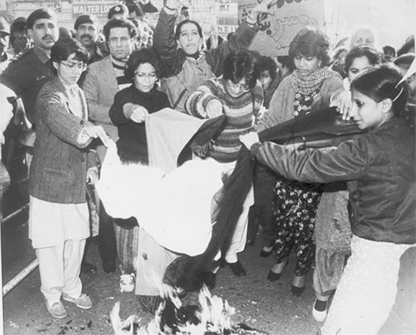 Progressive women activists burn their scarves to protest Zia's enforced morality laws in 1983