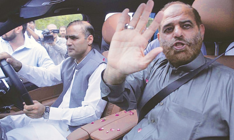 Tariq Shafi, cousin of Prime Minister Nawaz Sharif, waves while arriving on Sunday to appear before the JIT for the second time.— Online
