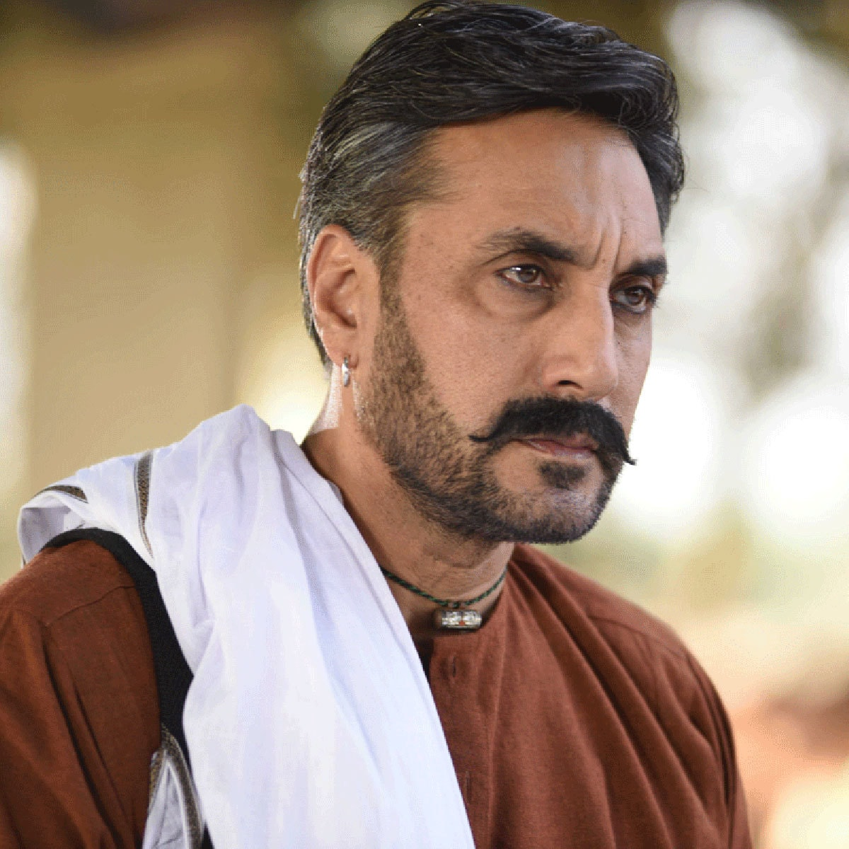 Adnan Siddiqui plays Rashid Chand, Chaudhry's conflicted slave/enforcer